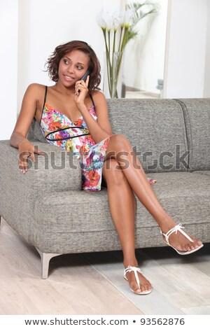 великолепный женщину телефон диване женщину дома счастливым Сток-фото © photography33