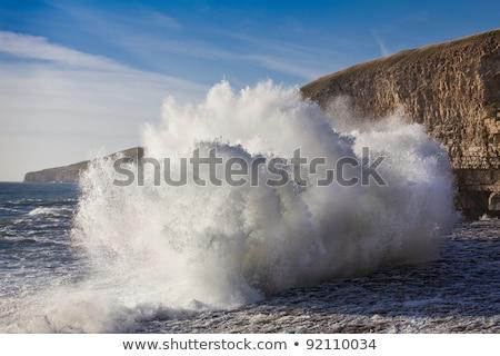 Kövek hullámok part Anglia tenger hullám Stock fotó © fisfra