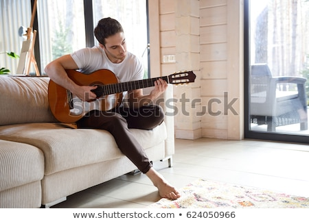 lezser · gitáros · tart · gitár · arc · fehér - stock fotó © photography33