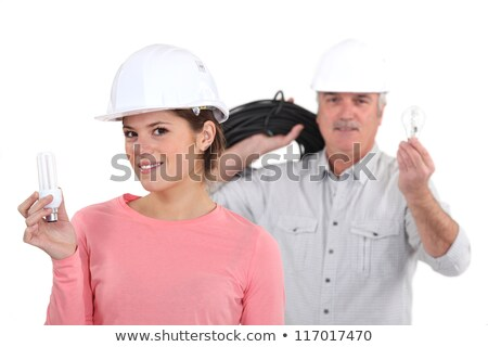 Tradespeople holding lightbulbs Stock photo © photography33