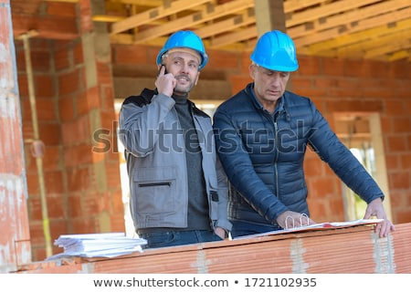 Contractor On The Phone Inspecting A Building Site Stock photo © stuartmiles