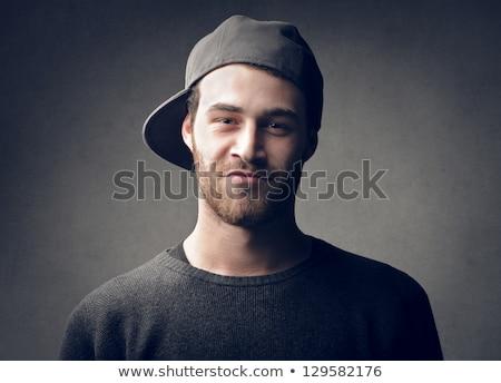 Portré fiatalember sapka afrikai leszármazás ül Stock fotó © ildi