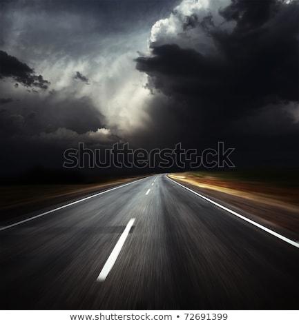Landelijk weg donkere onweerswolken gras natuur Stockfoto © Fesus