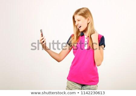Szőke nő néz mobiltelefon lány telefon internet Stock fotó © photography33