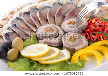 Stock photo: fish with vegetables,anion red pepper