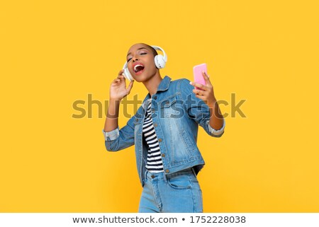 woman dancing listening to music stock photo © ariwasabi
