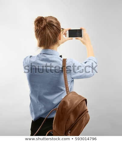 Mujer bonita toma vintage película cámara Foto stock © stryjek