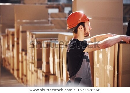 Young man working in a warehouse Stock photo © photography33