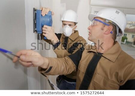 Man using power sander on wall Stock photo © photography33