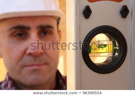 Builder spirito livello uomo vetro Foto d'archivio © photography33