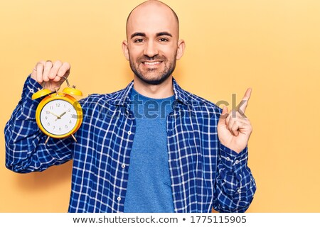 bald man showing a clock stock photo © photography33