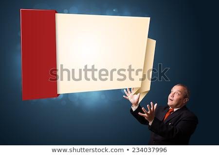 funny businessman presenting modern origami copy space stock photo © ra2studio