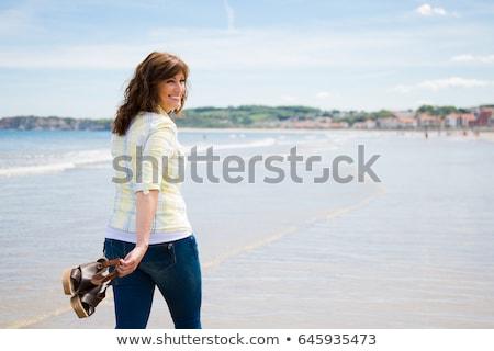 happy smiling woman walking on the beach Stock photo © dolgachov