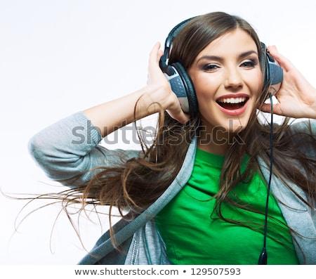 女子 聽音樂 白 微笑 面對 時尚 商業照片 © wavebreak_media