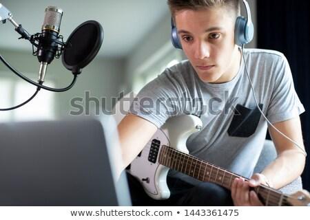Fiatal férfiak otthon hangszerek zene sör modell Stock fotó © photography33