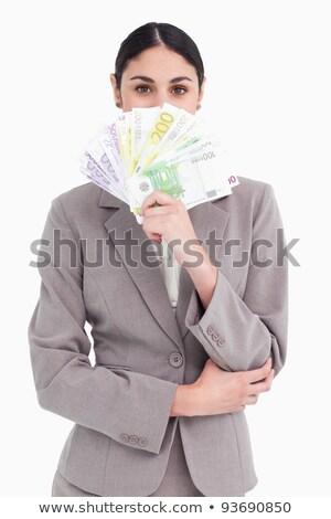 Empresária ocultação cara atrás banco notas Foto stock © wavebreak_media