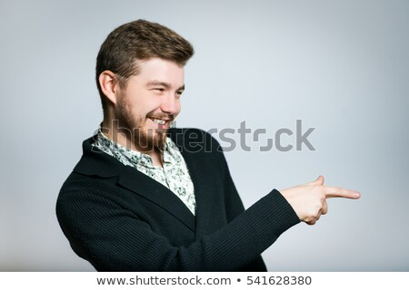Businessman laughing and pointing extended hand Stock photo © pablocalvog