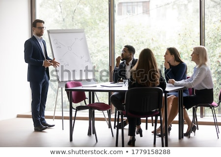 Businesswoman in front of a flipchart Stock photo © photography33