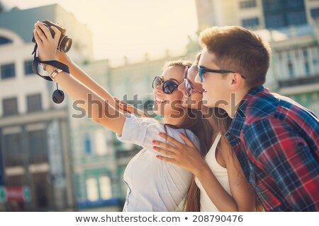 vacation couple taking pictures with camera phone stock photo © maridav