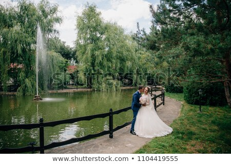 young adult couple looking at water fountain stock photo © tab62