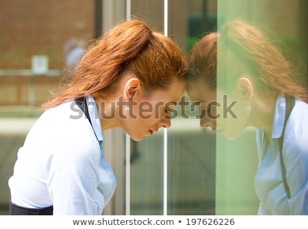 Upset, sad, troubled woman having a headache , bad day Stock photo © ichiosea