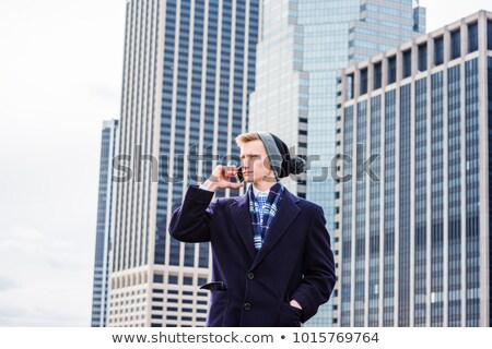 Corporate guy wearing long overcoat Stock photo © stockyimages