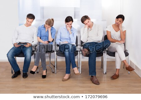 Man sitting on wooden chair and waiting Stock photo © stevanovicigor
