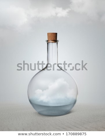 Small vintage glass bottle with water and cloud inside standing  Stock photo © hasloo