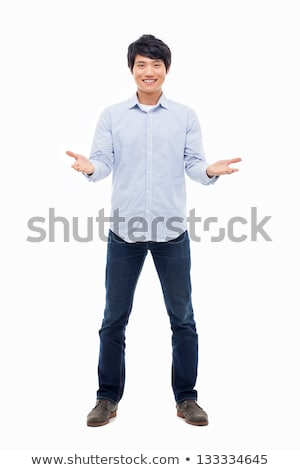 full length portrait of a happy asian man standing with arms folded over white background stock photo © deandrobot