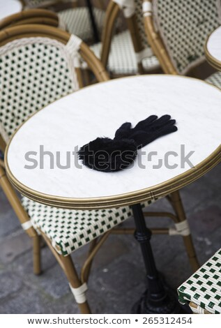 Forgotten Female Glove on a cafe table in Paris Stock photo © gemenacom