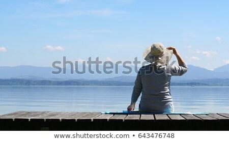 Supérieurs femme banc lac montagnes portrait Photo stock © belahoche