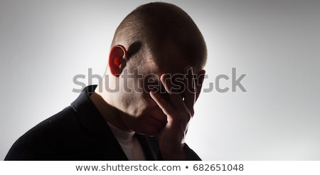 Black man holding his head in pain and depression Stock photo © master1305