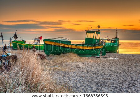 Foto d'archivio: Boat On The Sea At Sunset In Baltic Sea Poland