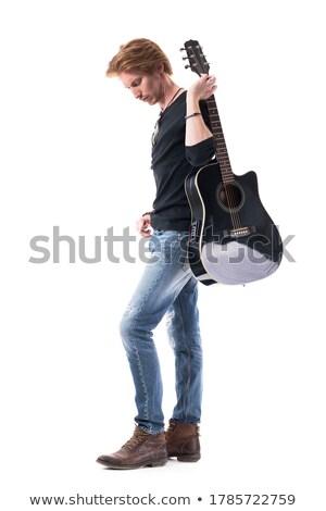 confident rocker in leather posing in studio looking down  Stock photo © feedough