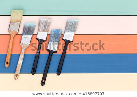 five cleaned used paintbrushes on stained wood stock photo © ozgur