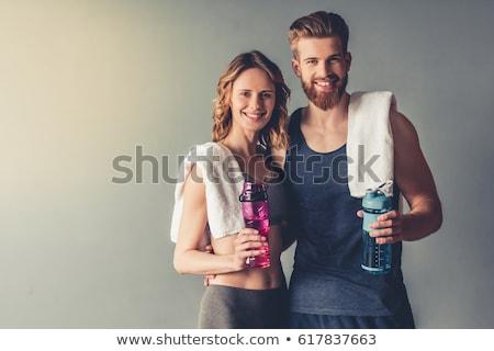 Bello bodybuilder asciugamano bottiglia nero sexy Foto d'archivio © wavebreak_media