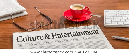 A newspaper on a wooden desk - Culture and Entertainment Stock photo © Zerbor