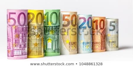 Euro banknotes in stacks and rolls Stock photo © RuslanOmega