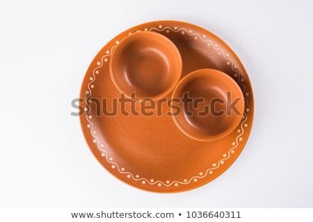 Terracotta serving bowl Stock photo © Digifoodstock