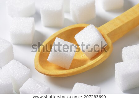 White sugar cubes in wooden scoop Stock photo © Digifoodstock