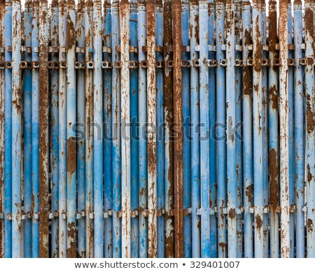 old rusty used scaffolding pipes on construction site stock photo © stevanovicigor