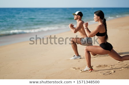 Mutlu çift çalışma plaj gün batımı kadın Stok fotoğraf © -Baks-