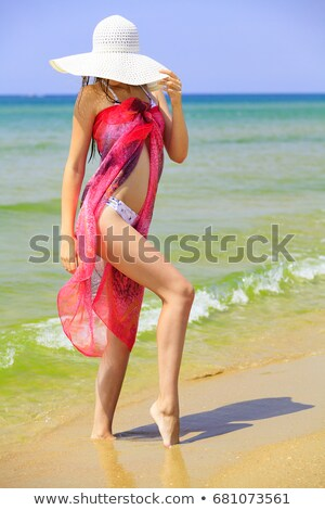 Woman in big straw sunhat sunbathing on a sandy beach. Summer ho Stock photo © Nobilior
