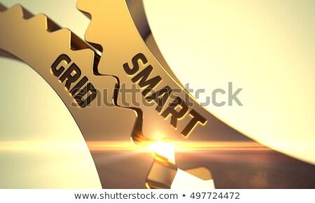 golden metallic cog gears with smart grid concept 3d stock photo © tashatuvango