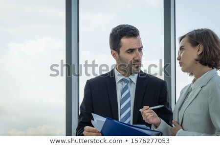 Boss overlooking co-workers Stock photo © IS2