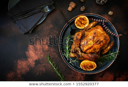 Whole roasted chicken in cooking tray. Top view stock photo © Virgin