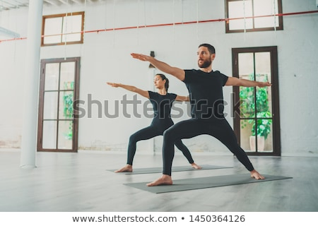 healthy young sports couple practicing yoga stock photo © deandrobot