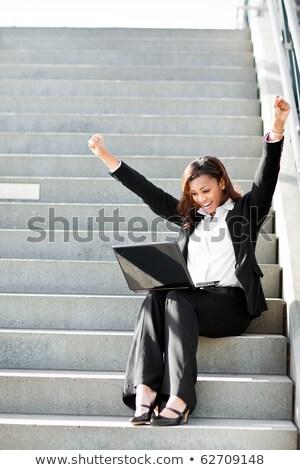 垂直 · 画像 · ビジネス女性 · 座って · 屋外 - ストックフォト © deandrobot