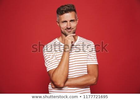 Caucasiano homem listrado tshirt pensando tocante Foto stock © deandrobot