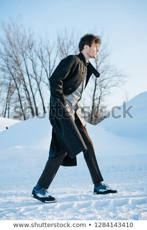 stylish  man walking with coat open and hand in pocket  Stock photo © feedough